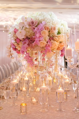 wedding centerpiece with white hydrangeas, white roses, white orchids, blush roses, pink orchids
