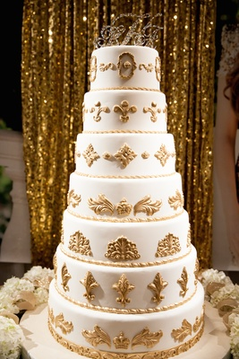 Seven layer cake with gold molds and fleur de lis