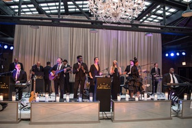 The Gold Coast All Stars at wedding in chicago revel motor row purple lighting drapery chandelier