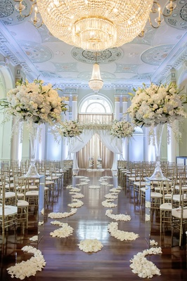 Wood floor aisle with ivory flower petals at The Biltmore Ballrooms