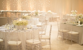 Ethereal wedding celebration bathed in candlelight