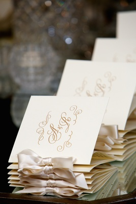 Embossed ceremony booklets with couple's initials