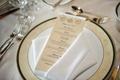 Wedding reception menu with bride and groom's monogram