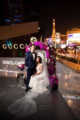 bride in cristiano lucci wedding dress, bride and groom on throne las vegas strip