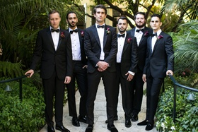 groom and groomsmen in tuxedos with burgundy calla lily boutonniere styles bow ties hotel bel-air