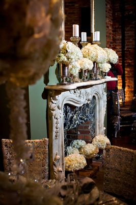 Fireplace mantle at Houmas House Plantation decorated with white rose and hydrangea flowers