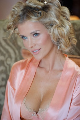 Joanna Krupa in pink lace bra and robe on wedding day
