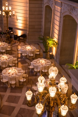 Wedding reception at the rotunda of San Francisco City Hall with golden lamps