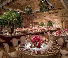 wedding reception for 700 guests gatsby garden theme green hedge pink flowers tree centerpieces