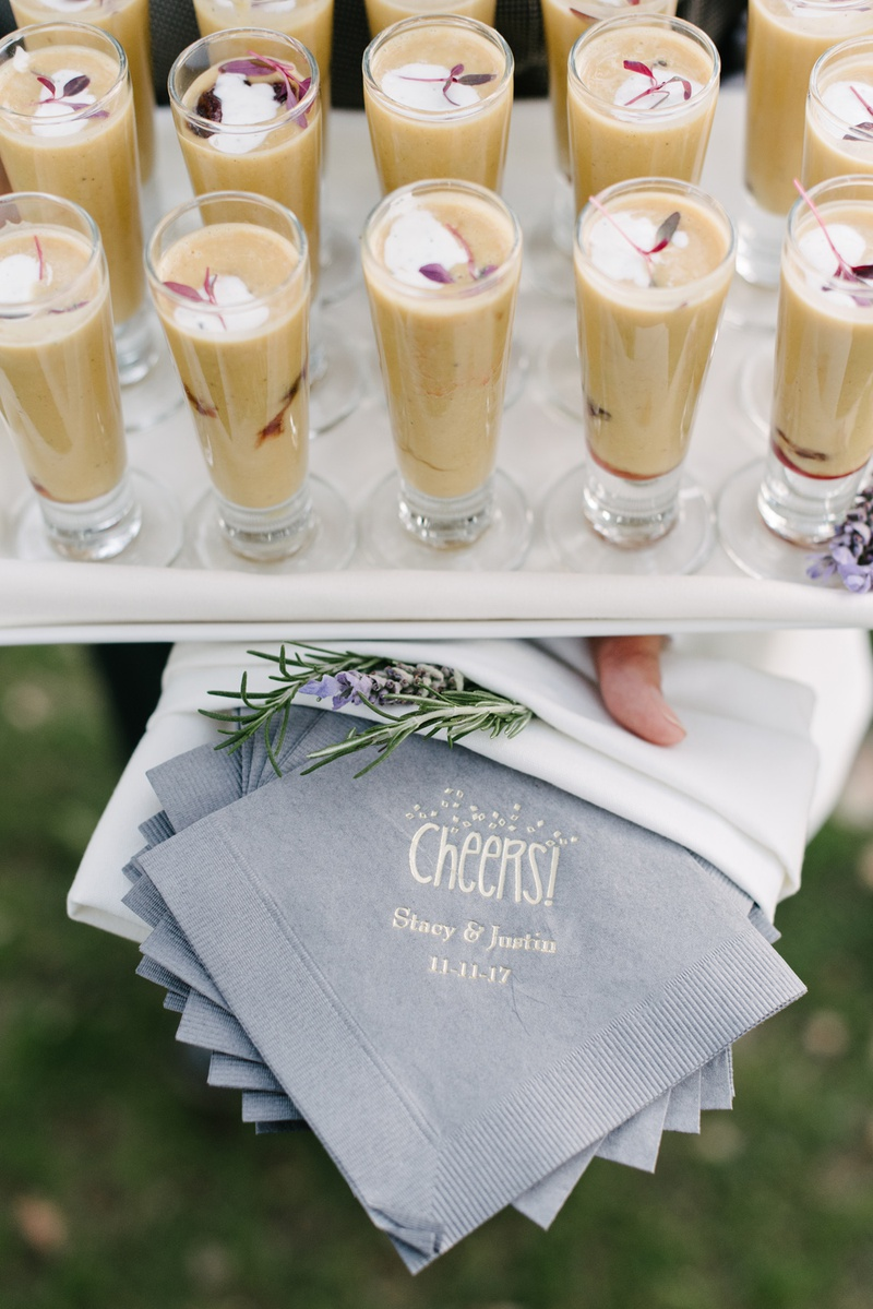 """fall wedding cocktail hour inspiration, grey cocktail napkins gold writing """"cheers"""""""