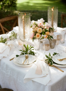 wedding reception square sweetheart table white linen tablecloth white cutout plates gold flatware