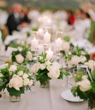 Pillar candles and small floral arrangements