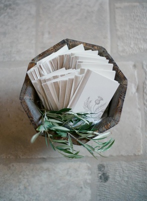Wood basket filled with herbs and ceremony booklets