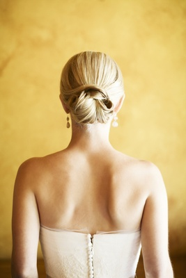 Blonde bride wearing wedding dress with updo