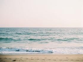 Sand and waves at Malibu beach wedding ceremony CJ Lana Perry and Miroslav Rusev Barnyashev