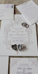Lehr and Black wedding invites with locket on top