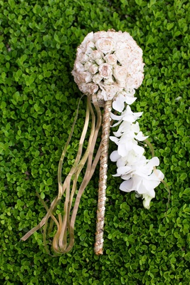 flower girl's gold wand topped with a pomander of ivory roses and cascading orchids