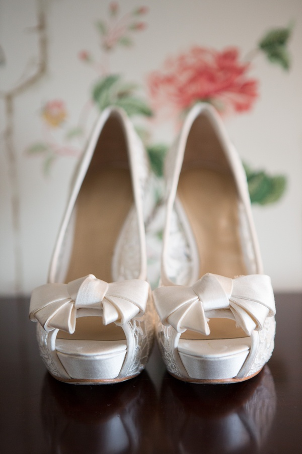 Lace peep-toe wedding heels with ivory bows