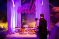 Purple lighting at cookies and milk bar tent wedding reception