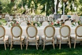 outdoor garden wedding reception oval back french style chairs long table short centerpieces trees