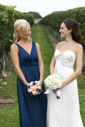 Maid of honor and bride outside Wolffer Vineyard