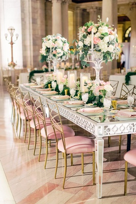 glam wedding reception mirror rectangular table gold chairs pink velvet cushions candelabra pink