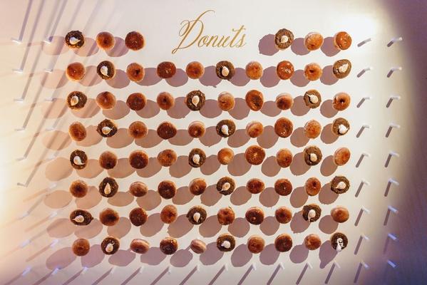 Wedding reception dessert ideas take home favor doughnut wall