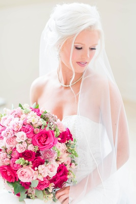 bride in strapless wedding dress updo veil pink rose bouquet large wedding portrait