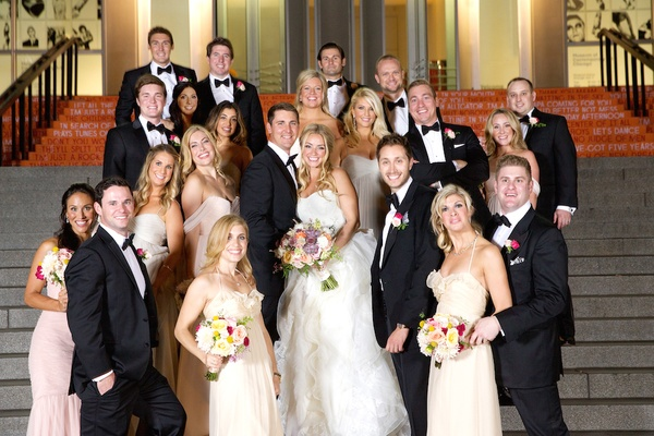 Bridesmaids and groomsmen outside on stairs