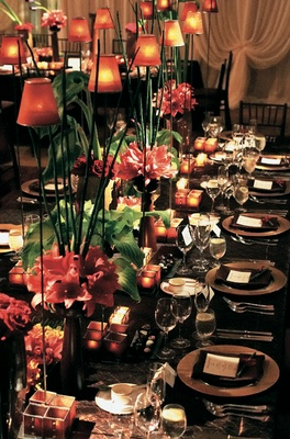 Long table with tall centerpieces and lamps