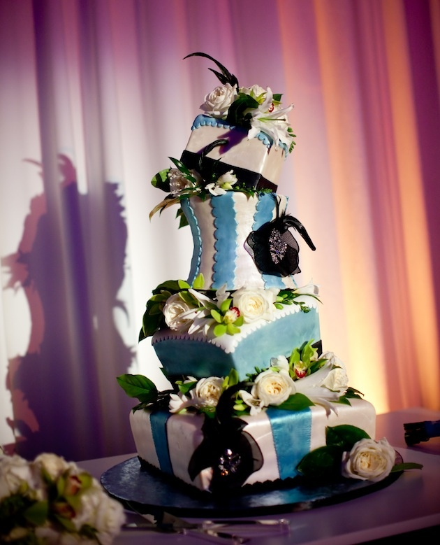 Blue and white tiltilng cake with black flowers
