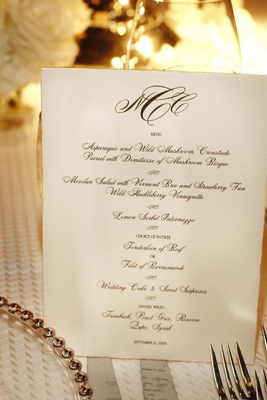Black and white menu with couple's monogram