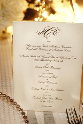Black and white menu with couple's monogram