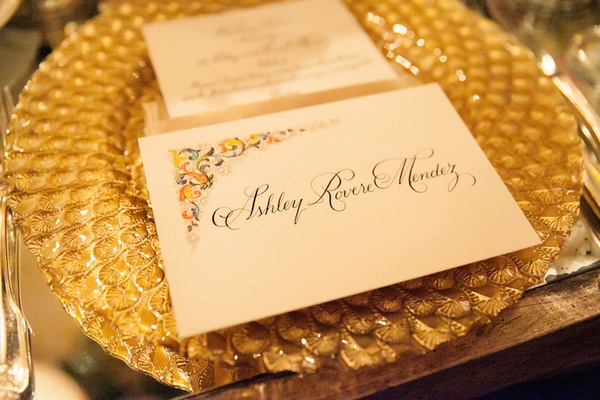 Gold charger plate with texture and unique escort card