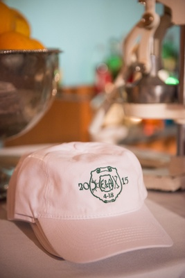 couple's favors were pink hats with custom logos embroidered to honor childhood camp where they met