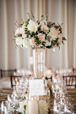 Wedding reception glass vase with pink garden rose ivory white dahlia flower dusty miller greenery