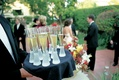 Trumpet shape champagne glasses on tray with formal waiter