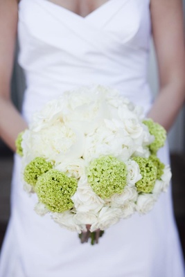 Bride holding white roses and green zinnias
