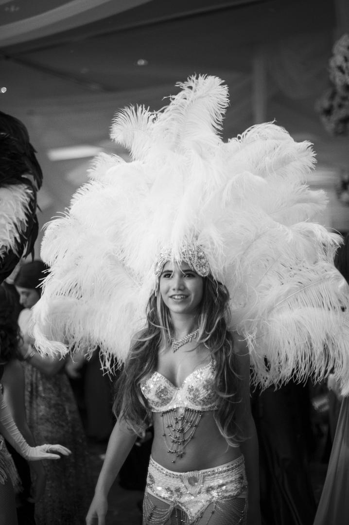 Black and white photo of feather headdress entertainer