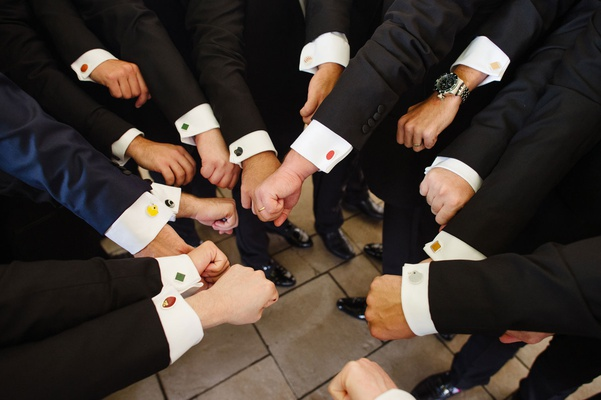 Groom and groomsmen with different cuff links sports logos for their favorite teams cufflinks