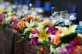 Flowers in tropical colors on edge of table