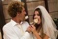 Bride and groom feed scoops of ice cream