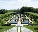 Oheka Castle in Huntington, New York wedding venue green lawn reflecting pool fountains trees