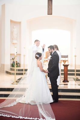 Virginia Catholic wedding ceremony bride in strapless wedding dress ball gown with lace trim cathedr
