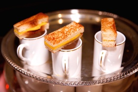 Wedding cocktail hour grilled cheese sandwiches & tomato soup in small china cups on silver tray