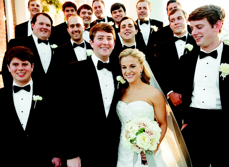 Bride and groom with male attendants in tuxedos