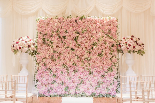 Wedding ceremony decor white drapery curtains white vase pink flowers pink green flower wall altar