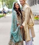 bride and groom posing in traditional pakistani garb before their shaadi wedding ceremony
