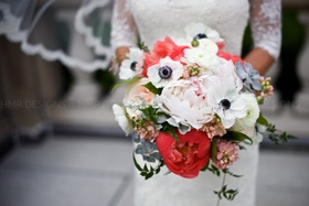 Lush and lovely summer blooms come together beautifully for an ample bridal bouquet.