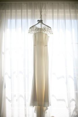 gown lace neckline details hanging window southern california wedding sheath classic simple